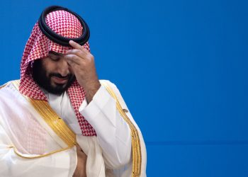 "30 November 2018, Argentina, Buenos Aires: Mohammed bin Salman, Saudi Crown Prince, is waiting for the family photo of all participants at the G20 Summit Conference Centre in Buenos Aires. From 30.11.-1.12.2018 the G20 summit will take place in Buenos Aires. The ""Group of 20"" unites the strongest industrial nations and emerging economies. Photo: Ralf Hirschberger/dpa (Photo by Ralf Hirschberger/picture alliance via Getty Images)"