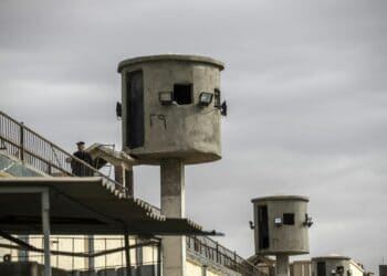 A picture taken during a guided tour organised by Egypt's State Information Service on February 11, 2020, shows an Egyptian policeman near watch towers at Tora prison in the Egyptian capital Cairo. (Photo by Khaled DESOUKI / AFP) (Photo by KHALED DESOUKI/AFP via Getty Images)