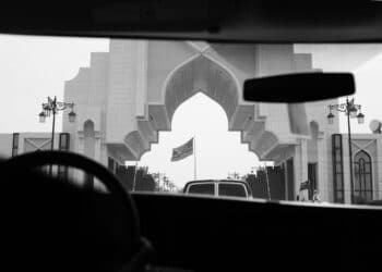 An entrance to the Saudi Royal Court is seen from inside of a press van as the motorcade of US President Donald Trump arrives in Riyadh on May 20, 2017. / AFP PHOTO / MANDEL NGAN        (Photo credit should read MANDEL NGAN/AFP via Getty Images)