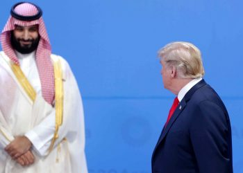 BUENOS AIRES, ARGENTINA - NOVEMBER 30: U.S. President Donald Trump looks over at Crown Prince of Saudi Arabia Mohammad bin Salman al-Saud as they line up for the family photo during the opening day of Argentina G20 Leaders' Summit 2018 at Costa Salguero on November 30, 2018 in Buenos Aires, Argentina. (Photo by Daniel Jayo/Getty Images)