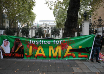People hold a banner demanding justice for Jamal Khashoggi during a protest outside the Saudi Arabian embassy in central London. (Photo by Jonathan Brady/PA Images via Getty Images)