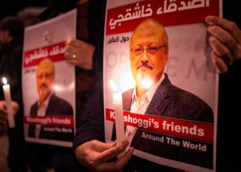 People hold posters picturing Saudi journalist Jamal Khashoggi and lightened candles during a gathering outside the Saudi Arabia consulate in Istanbul, on October 25, 2018. - Jamal Khashoggi, a Washington Post contributor, was killed on October 2, 2018 after a visit to the Saudi consulate in Istanbul to obtain paperwork before marrying his Turkish fiancee. (Photo by Yasin AKGUL / AFP)        (Photo credit should read YASIN AKGUL/AFP via Getty Images)