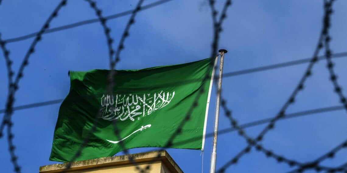 A Saudi Arabian flag flies behind barbed wires at the Saudi Arabian consulate in Istanbul on October 12, 2018. - Saudi Arabia's ambassador to Britain expressed concern about the fate of a journalist who vanished after entering its Istanbul consulate last week.But Prince Mohammed bin Nawaf al Saud told the BBC he needed to wait for the results of an investigation before commenting further about Jamal Khashoggi's fate. (Photo by OZAN KOSE / AFP)        (Photo credit should read OZAN KOSE/AFP via Getty Images)
