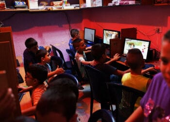 BEIRUT, LEBANON - JULY 01:  An internet cafe is utilized by young Lebanese and Syrian children in a poor neighborhood with a high concentration of Syrian refugees on July 01, 2013 in Beirut, Lebanon. Currently the Lebanese government officially hosts 546,000 Syrians with an estimated additional 500,000 who have not registered with the United Nations. Lebanon, a country of only 4 million people, is now home to the largest number of Syrian refugees who have fled the conflict. The situation is beginning to put a huge social and political strains on Lebanon as there is currently no end in sight to the war in Syria.  (Photo by Spencer Platt/Getty Images)