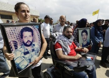 People carry on September 15, 2019, pictures of relatives who were killed during the Israeli occupation of south Lebanon, as they take part in a demonstration in front of the former Israeli-run prison of Khiyam on the border with Israel, to demand the trial of a former member of the pro-Israel South Lebanon Army SLA who has recently been arrested. - Lebanon has reportedly detained Amer al-Fakhoury, a senior member of a disbanded Israel-backed militia SLA, and a senior warden in the notorious SLA-run Khiyam prison, after his return to the country sparked widespread condemnation and revived accusations of torture. (Photo by JOSEPH EID / AFP)        (Photo credit should read JOSEPH EID/AFP via Getty Images)