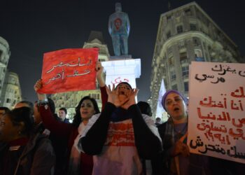 Egyptian protesters hold up placards and shout slogans during a demonstration in Cairo against sexual harassment on February 12, 2013. Egyptian protesters took to the street again to demand an end to sexual violence, as campaigns against the repeated attacks in central Cairo pick up steam. Sexual harassment has long been a problem in Egypt, but recently the violent nature and frequency of the attacks have raised the alarm.   AFP PHOTO / KHALED DESOUKI        (Photo credit should read KHALED DESOUKI/AFP via Getty Images)