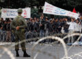 TUNIS, TUNISIA - JANUARY 24:  Protesters congregate outside the formerly feared Interior Ministry on Avenue Habib Bourguiba on January 24, 2011 in Tunis, Tunisia. Protesters from the countryside and the hamlet of Sidi Bouzid, the town where the 'Jasmine Revolution' started, walked through the night to descend on the prime minsiters office where they tore down razor wire barricades.  (Photo by Christopher Furlong/Getty Images)
