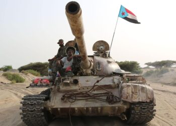 TOPSHOT - Fighters of the UAE-trained Security Belt Force, dominated by members of the the Southern Transitional Council (STC) which seeks independence for south Yemen, ride atop a tank in Yemen's southern coastal town of Shuqrah, east of the city of Aden, on August 27, 2019. - Saudi Arabia and the United Arab Emirates renewed a call earlier this week for peace talks between Yemen's government and southern separatists, urging a ceasefire following deadly clashes. (Photo by - / AFP) (Photo by -/AFP via Getty Images)