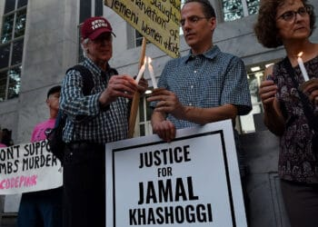 People gather in front of the Embassy of Saudi Arabia on October 2, 2019 in Washington, DC, to remember Jamal Khashoggi, a Saudi journalist and a Washington Post contributing columnist, killed by a team of assassins at the Saudi Arabian consulate in Istanbul. - Amazon founder and Washington Post owner Jeff Bezos joined activists in Istanbul Wednesday for a memorial service outside the Saudi consulate where journalist Jamal Khashoggi was murdered a year ago. (Photo by Olivier Douliery / AFP) (Photo by OLIVIER DOULIERY/AFP via Getty Images)