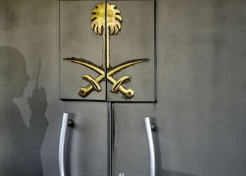 A shadow of a security member of the consulate is seen on the door of the Saudi Arabian consulate on November 1, 2018 in Istanbul. - Journalist Jamal Khashoggi was strangled as soon as he entered the Saudi consulate in Istanbul and his body was dismembered and destroyed as part of a premeditated plan, Turkey's chief prosecutor said on October 31, making details of the murder public for the first time. (Photo by OZAN KOSE / AFP)        (Photo credit should read OZAN KOSE/AFP via Getty Images)