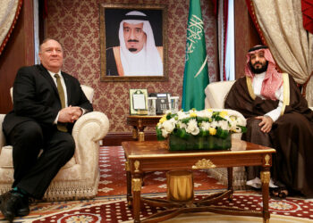 Seated under a portrait of the Saudi monarch, US Secretary of State Mike Pompeo (L) meets with Saudi Arabia's Crown Prince Mohammed bin Salman at Al Salam Palace in the Red Sea port of Jeddah on June 24, 2019. - Pompeo arrived Monday in Saudi Arabia for talks on coordinating with the close ally amid mounting tensions with Iran. (Photo by Jacquelyn Martin / POOL / AFP)        (Photo credit should read JACQUELYN MARTIN/AFP via Getty Images)