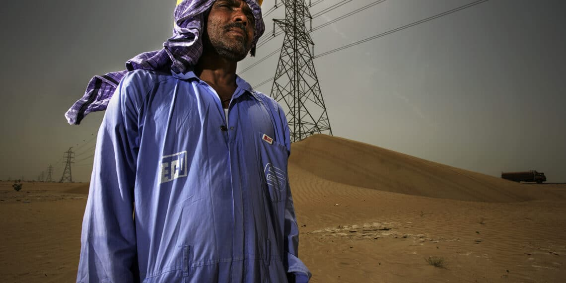 Sharjar, UAE, May 2006: A portrait of a migrant labourer in an area close to  Dubai where he is installing a well for ongoing construction. He is one of over a million construction workers working in Dubai. These sites are filled with construction labourers in Dubai live in labour camps.The camps are often over 2 hours away and the workers have just finished a 12 hour shift. The majority of labourers come to Dubai from India, Pakistan and Bangladesh. These workers operate in extreme temperatures in the desert climate, the majority earning under $200 a month. Many have to spend a third of that sum on food provided at the camps as part of their contract. Most sign recruitment contracts in their own countries which take them into debt for many years. Their passports are held by their employers once they reach the UAE and if the company owners abscond the workers are often abandoned without their documents or due payment. Over two thirds of the Dubai population is migrant labour with 1.1 million working in construction. Dubai is currently second only to Shanghai in terms of the scale of construction underway on a 24 hour basis. All this is woefully underscrutinised by the Ministry of Labour, there are currently only 80 government inspectors for over 200 000 construction companies. Recently there have been rumblings of discontent from the workers, with strikes at numerous sites over the non-payment of wages and harsh working conditions. In 2005, according to Human Rights Watch, there were 84 suicides by construction workers in Dubai. Photo by Brent Stirton/Getty Images.