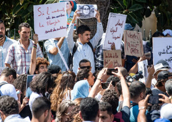 Demonstrators hold up signs showing the portraits of Hajar Raissouni, a Morrocan journalist of the daily newspaper Akhbar El-Youm, as they gather outside a courthouse holding her trial on charges of abortion in the capital Rabat on September 9, 2019. (Photo by FADEL SENNA / AFP) / The erroneous mention[s] appearing in the metadata of this photo by FADEL SENNA has been modified in AFP systems in the following manner: [the capital Rabat] instead of [Marrakesh]. Please immediately remove the erroneous mention[s] from all your online services and delete it (them) from your servers. If you have been authorized by AFP to distribute it (them) to third parties, please ensure that the same actions are carried out by them. Failure to promptly comply with these instructions will entail liability on your part for any continued or post notification usage. Therefore we thank you very much for all your attention and prompt action. We are sorry for the inconvenience this notification may cause and remain at your disposal for any further information you may require.        (Photo credit should read FADEL SENNA/AFP via Getty Images)