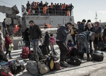MYTILENE, GREECE - FEBRUARY 27: In Lesbos Mytilene port, refugees from Syria and Iraq collect their belonging after disembarking a Greek Coast Guard vessel who picked them up at sea from three incoming rubber boats.  Mytilene, Greece on 27 February, 2016. Lesbos, the Greek vacation island in the Aegean Sea between Turkey and Greece, faces massive refugee flows from the Middle East countries.  (Photo by Etienne De Malglaive/Getty Images)