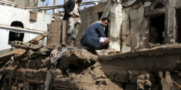 SANA'A, YEMEN – JUNE 25: People search for survivors under rubble of a house after it was destroyed by an airstrike of the Saudi-led coalition, that killed eight members of one family, and injured 15 others on June 25, 2018 in Amran province north Sana'a, Yemen. (Photo by Mohammed Hamoud/Getty Images)