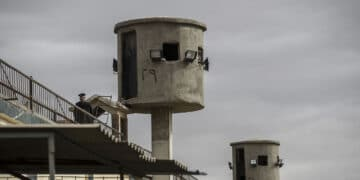 A picture taken during a guided tour organised by Egypt's State Information Service on February 11, 2020, shows an Egyptian policeman near watch towers at Tora prison on the southern outskirts of the Egyptian capital Cairo. (Photo by Khaled DESOUKI / AFP) (Photo by KHALED DESOUKI/AFP via Getty Images)