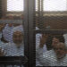 CAIRO, EGYPT - MARCH 6:  Muslim Brotherhood Leader Mohamed Badie (R) and 47 other defendants stand behind bars during the trial of Brotherhood members at a courtroom on March 6, 2014 in Cairo, Egypt. A Cairo court on Thursday adjourned to March 11 the trial of Muslim Brotherhood leader Mohamed Badie and 47 other defendants charged with inciting violence in Egypt's Qalioubiya province last summer, judicial sources said. (Photo by Ahmed Jamil/Anadolu Agency/Getty Images)