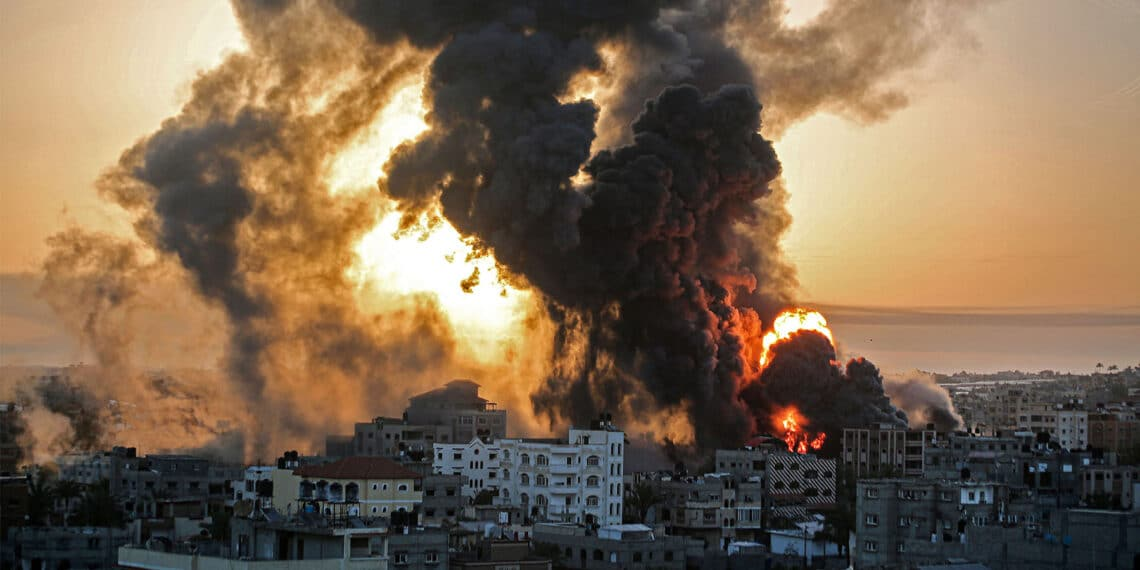 A fire rages at sunrise in Khan Yunis following an Israeli airstrike in the southern Gaza Strip, May 12, 2021. (Photo by Youssef Massoud/AFP via Getty Images)