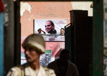 An Egyptian army conscript stands guard outside a polling station before the start of Egypt's 2018 presidential elections, in Giza, March 26, 2018. (Photo by Khaled Desouki/AFP via Getty Images)