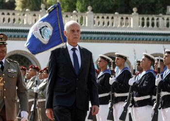 23 October 2019, Tunisia, Carthage: Kais Saied (2nd L) inspects the guard of honour upon his arrival at the Carthage Palace after his swearing-in ceremony where he took an oath as Tunisia's new President. Photo: Khaled Nasraoui/dpa (Photo by Khaled Nasraoui/picture alliance via Getty Images)