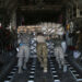 UNSPECIFIED, PERSIAN GULF REGION - JANUARY 10:  U.S. Air Force service members push cargo onto a Texas Air National Guard C-130 cargo plane bound for Iraq on January 10, 2016 from a base in an undisclosed location in the Persian Gulf Region. The U.S. military and coalition forces use the base to transport troops and equipment supporting Operation Inherent Resolve against the Islamic State. They also launch unmanned drones from the base to target ISIL positions in the region.  (Photo by John Moore/Getty Images)
