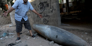 A Palestinian man reacts as he looks at an unexploded bomb dropped by an Israeli F-16 warplane on Gaza City's Rimal neighbourhood on May 18, 2021. - The UN Security Council was due to hold an emergency meeting today amid a flurry of urgent diplomacy aimed at stemming Israel air strikes that have killed more than 200 Palestinians. (Photo by Majdi Fathi/NurPhoto via Getty Images)