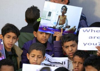 Yemeni children demonstrate on the occasion of the UN's Universal Children's Day on November 20, 2017 in front of the UN offices in the capital Sanaa, as they protest against the air strikes carried out by the Saudi-led coalition. / AFP PHOTO / Mohammed HUWAIS        (Photo credit should read MOHAMMED HUWAIS/AFP via Getty Images)